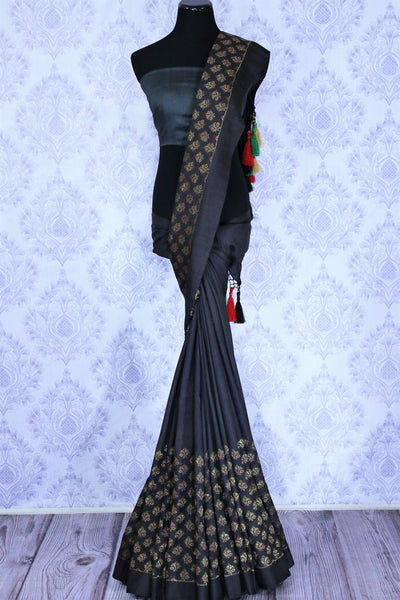 Black georgette Banarasi saree for online shopping in USA. The classy saree is decorated with buta on the border which makes it so captivating. Select from an exquisite collection of traditional Indian Banarasi sarees, designer saris at Pure Elegance clothing store or shop online.-full view