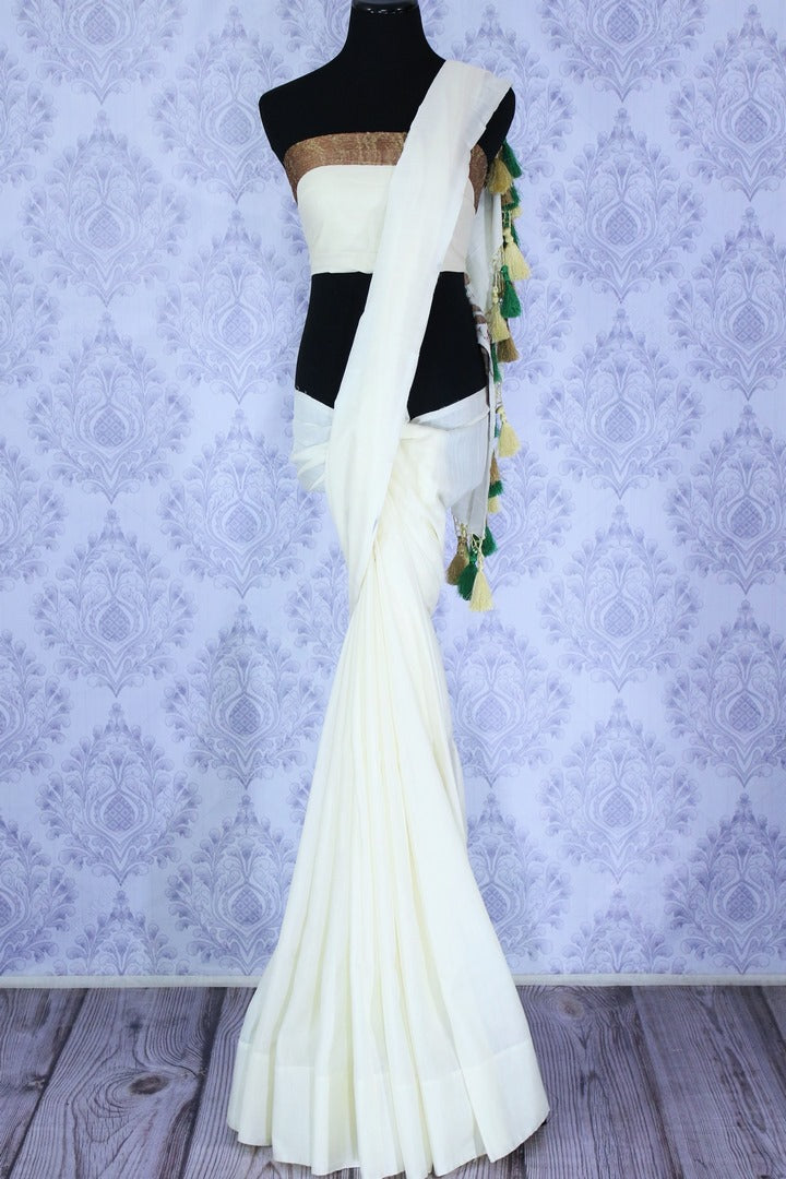 Buy classic white muga Banarasi sari online in USA. Select from an exquisite collection of traditional Indian Banarasi sarees, silk sarees at Pure Elegance clothing store or shop online for weddings, parties, and festivals.-full view