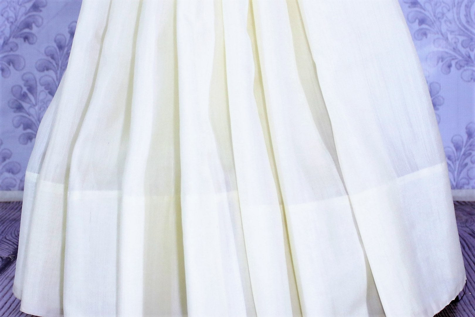 Buy classic white muga Banarasi sari online in USA. Select from an exquisite collection of traditional Indian Banarasi sarees, silk sarees at Pure Elegance clothing store or shop online for weddings, parties, and festivals.-pleats