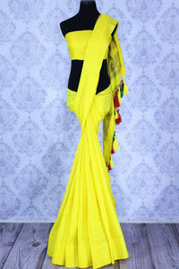Buy lemon yellow muga Banarasi sari online in USA. The bright saree is a great choice for a classic Indian saree look at special occasions. Select from an exquisite collection of traditional Indian Banarasi sarees, silk sarees at Pure Elegance clothing store or shop online for weddings, parties, and festivals.-full view