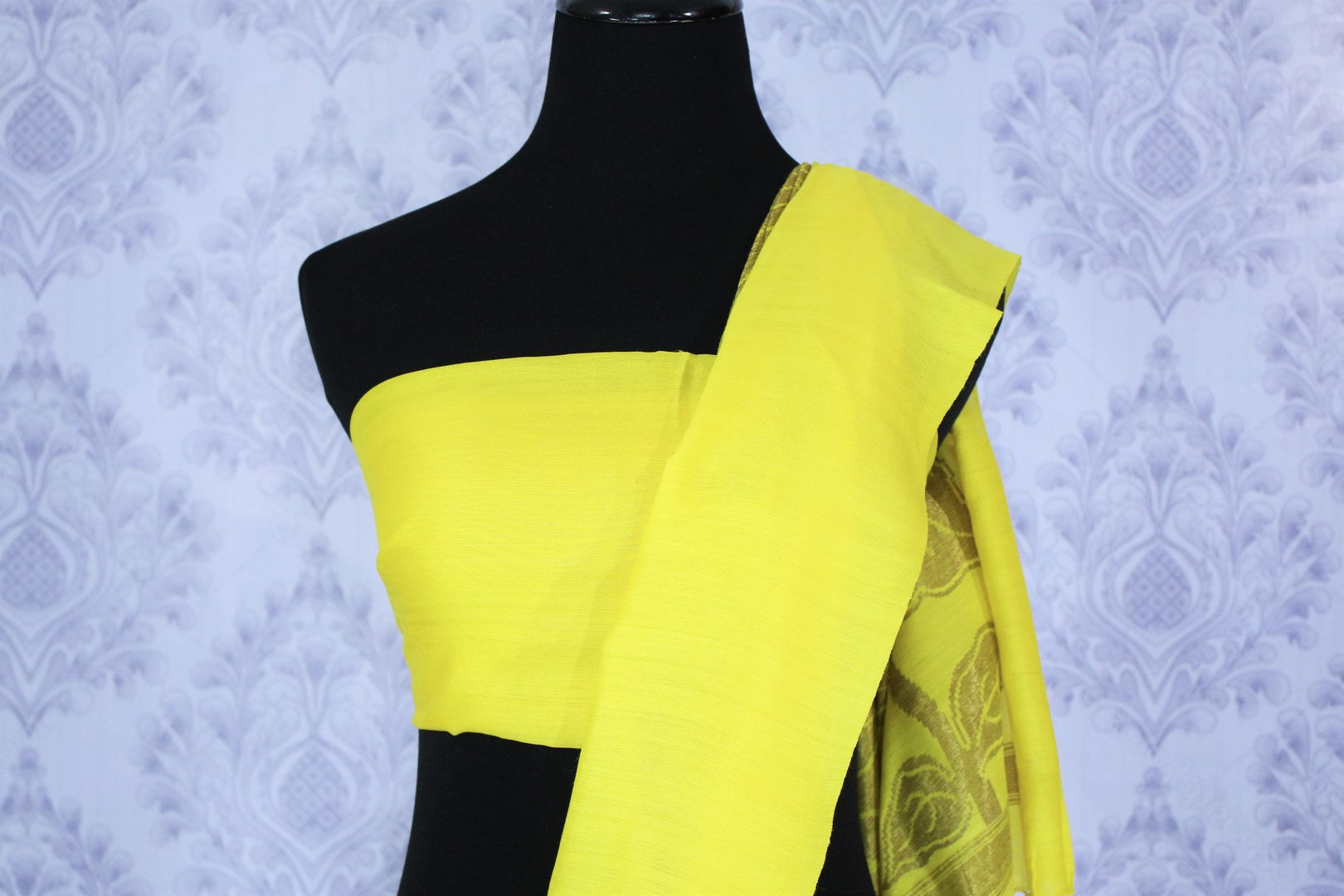 Buy lemon yellow muga Banarasi sari online in USA. The bright saree is a great choice for a classic Indian saree look at special occasions. Select from an exquisite collection of traditional Indian Banarasi sarees, silk sarees at Pure Elegance clothing store or shop online for weddings, parties, and festivals.-blouse pallu