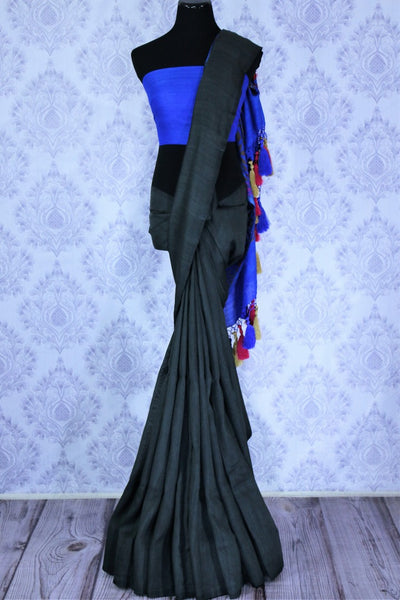 Buy black muga Banarasi sari online in USA with blue pallu. The beautiful saree is a great choice for a classic Indian saree look at special occasions. Select from an exquisite collection of traditional Indian Banarasi sarees, silk saris at Pure Elegance clothing store or shop online for weddings, parties, and festivals.-full view