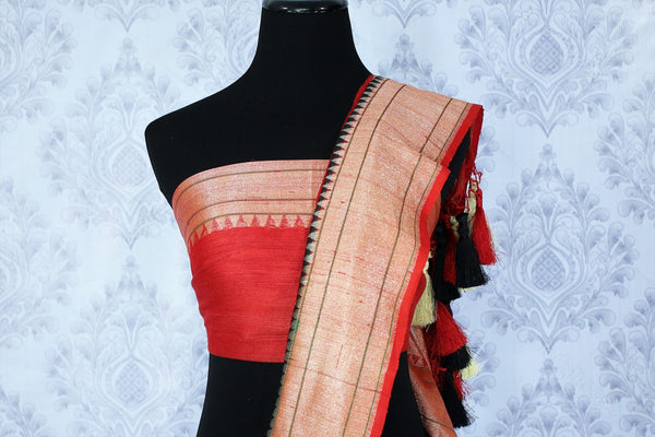 Buy black tussar saree with red zari border online in USA. The beautiful saree is a great choice for a classic Indian look at special occasions. Select from an exquisite collection of traditional Indian sarees, silk saris at Pure Elegance clothing store or shop online for weddings, parties, and festivals.-blouse pallu