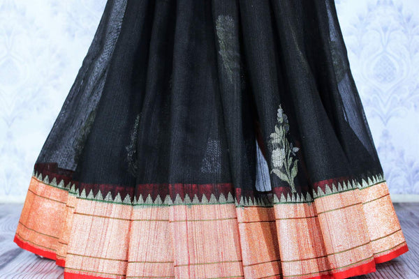 Buy black tussar saree with red zari border online in USA. The beautiful saree is a great choice for a classic Indian look at special occasions. Select from an exquisite collection of traditional Indian sarees, silk saris at Pure Elegance clothing store or shop online for weddings, parties, and festivals.-pleats