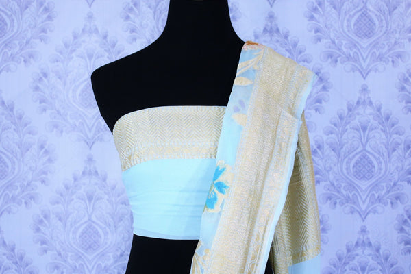Buy sky blue georgette Banarasi saree online in USA. The alluring design of the saree with  golden pallu and border and minakari work makes it perfect for a traditional look. Select from an exquisite collection of traditional Indian Banarasi sarees, designer saris at Pure Elegance clothing store or shop online.-blouse pallu