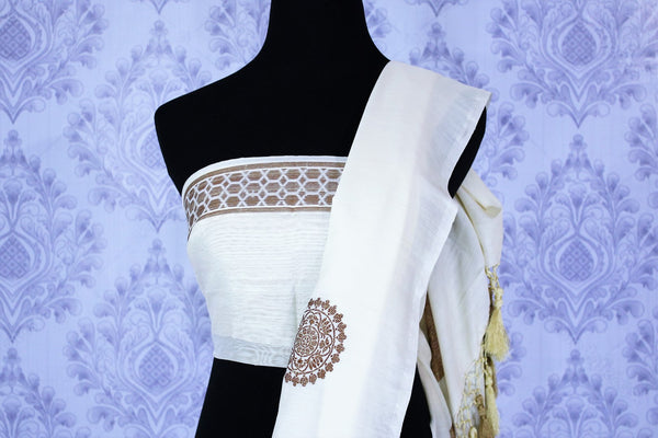 Buy classic off-white muga Banarasi sari online in USA with buta. The striking saree is a great choice to keep it simple and ethnic at special occasions. Select from an exquisite collection of traditional Indian Banarasi saris at Pure Elegance clothing store or shop online for occasions like weddings, parties, and festivals.-blouse pallu