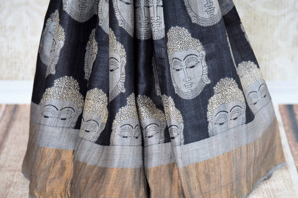 Buy online black tussar silk saree in USA with Budda face print. The saree is an alluring drape for a classic Indian look. If you are looking for Indian handloom sarees, silk saris in USA, then Pure Elegance is the place for you. Shop online or visit our exclusive fashion store in USA.-pleats