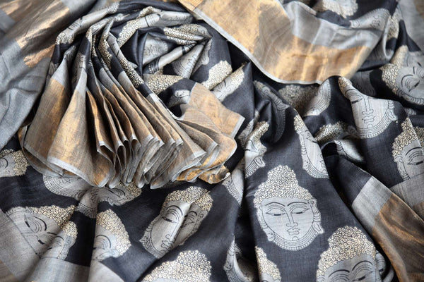 Buy online black tussar silk saree in USA with Budda face print. The saree is an alluring drape for a classic Indian look. If you are looking for Indian handloom sarees, silk saris in USA, then Pure Elegance is the place for you. Shop online or visit our exclusive fashion store in USA.-details