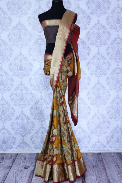 Buy mustard yellow printed silk sari online in USA. The saree has a shining Benarasi zari border is a bright and beautiful choice for parties.  Buy more such beautiful Indian Banarasi saris in USA at Pure Elegance fashion store and keep it ethnic at every occasion.-full view
