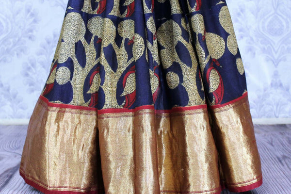 Buy dark blue printed silk saree online in USA. The saree has a golden Benarasi zari border is a bright and beautiful choice for parties.  Buy more such beautiful Indian silk sarees in USA at Pure Elegance clothing store and keep it ethnic at every occasion.-pleats