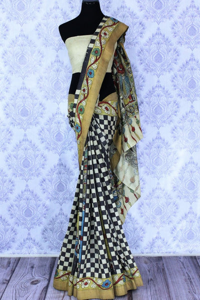 Buy beige and black tussar saree online in USA with kalamkari print. The saree is an alluring choice for festive occasions.  Buy more such traditional Indian designer saris in USA from Pure Elegance clothing store and keep it ethnic at every occasion.-full view