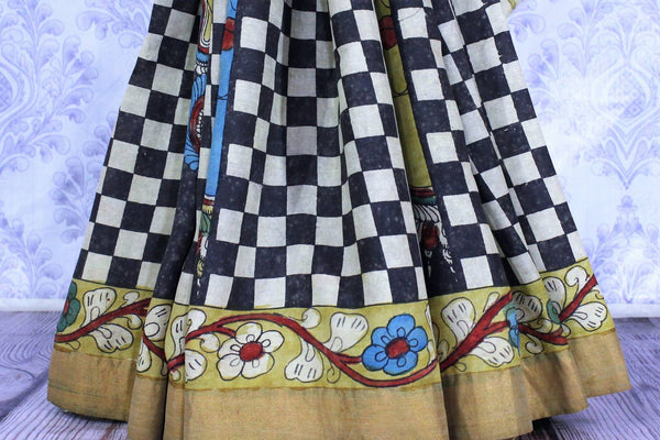 Buy beige and black tussar saree online in USA with kalamkari print. The saree is an alluring choice for festive occasions.  Buy more such traditional Indian designer saris in USA from Pure Elegance clothing store and keep it ethnic at every occasion.-pleats