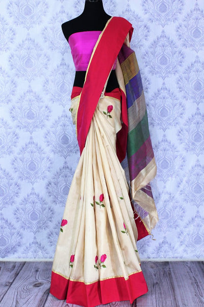 Buy classic cream silk saree online in USA with embroidered rose motifs. The saree is an alluring choice for a traditional look at festive occasions.  Buy more such traditional Indian designer sarees in USA from Pure Elegance clothing store and keep it ethnic at every occasion.-full view