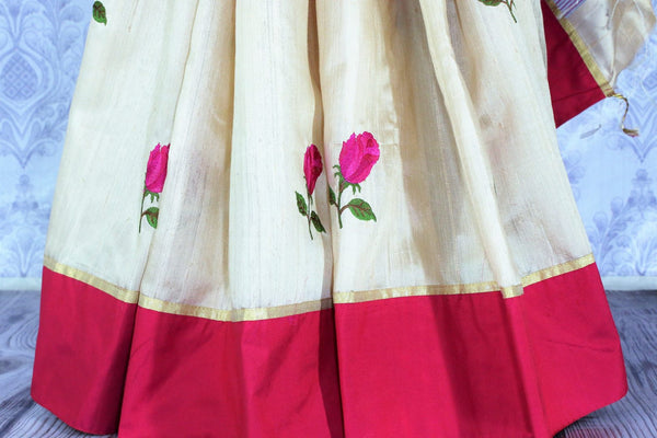 Buy classic cream silk saree online in USA with embroidered rose motifs. The saree is an alluring choice for a traditional look at festive occasions.  Buy more such traditional Indian designer sarees in USA from Pure Elegance clothing store and keep it ethnic at every occasion.-pleats