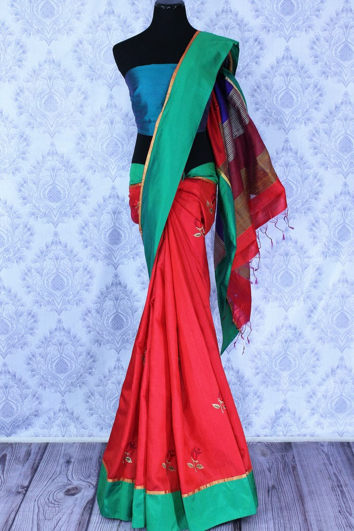Buy bright red silk sari online in USA with embroidered rose motifs. The saree is an alluring choice for a traditional Indian look at festive occasions.  Buy more such traditional Indian designer silk sarees in USA from Pure Elegance clothing store and keep it ethnic at every occasion.-full view
