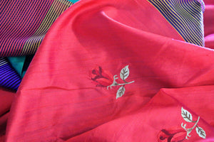 Buy bright red silk sari online in USA with embroidered rose motifs. The saree is an alluring choice for a traditional Indian look at festive occasions.  Buy more such traditional Indian designer silk sarees in USA from Pure Elegance clothing store and keep it ethnic at every occasion.-details