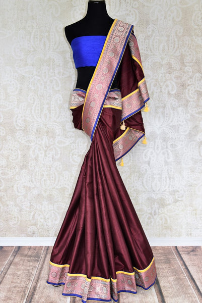 Drape the gorgeous Maroon silk saree with a glorious banarsi silk border. Style this silk sari with a contrasting blue beautiful raw silk blouse and the pretty tassel drops on the pallu to turn heads.  Shop such handcrafted silk saris, handloom sarees, embroidered saris online or visit Pure Elegance store in USA. -full view