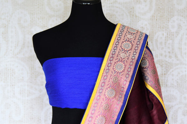 Drape the gorgeous Maroon silk saree with a glorious banarsi silk border. Style this silk sari with a contrasting blue beautiful raw silk blouse and the pretty tassel drops on the pallu to turn heads.  Shop such handcrafted silk saris, handloom sarees, embroidered saris online or visit Pure Elegance store in USA. -blouse pallu