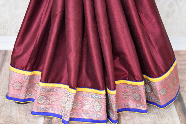 Drape the gorgeous Maroon silk saree with a glorious banarsi silk border. Style this silk sari with a contrasting blue beautiful raw silk blouse and the pretty tassel drops on the pallu to turn heads.  Shop such handcrafted silk saris, handloom sarees, embroidered saris online or visit Pure Elegance store in USA. -pleats