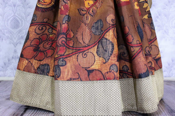 Buy elegant brown floral Kalamkari print tussar saree online in USA. The saree is an alluring choice for a traditional Indian look at special occasions.  Buy more such traditional Indian sarees in USA from Pure Elegance clothing store and stand out with ethnic elegance.-pleats