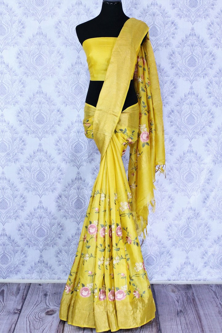Buy bright yellow silk linen saree online in USA with resham embroidery. Beautifully decorated with floral embroidery and golden border, the saree makes a great choice for daytime festivities or parties. Choose your favorite Indian saree from an exclusive collection available at Pure Elegance clothing store in USA.-full view