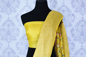 Buy bright yellow silk linen saree online in USA with resham embroidery. Beautifully decorated with floral embroidery and golden border, the saree makes a great choice for daytime festivities or parties. Choose your favorite Indian saree from an exclusive collection available at Pure Elegance clothing store in USA.-blouse pallu