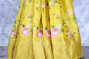 Buy bright yellow silk linen saree online in USA with resham embroidery. Beautifully decorated with floral embroidery and golden border, the saree makes a great choice for daytime festivities or parties. Choose your favorite Indian saree from an exclusive collection available at Pure Elegance clothing store in USA.-pleats