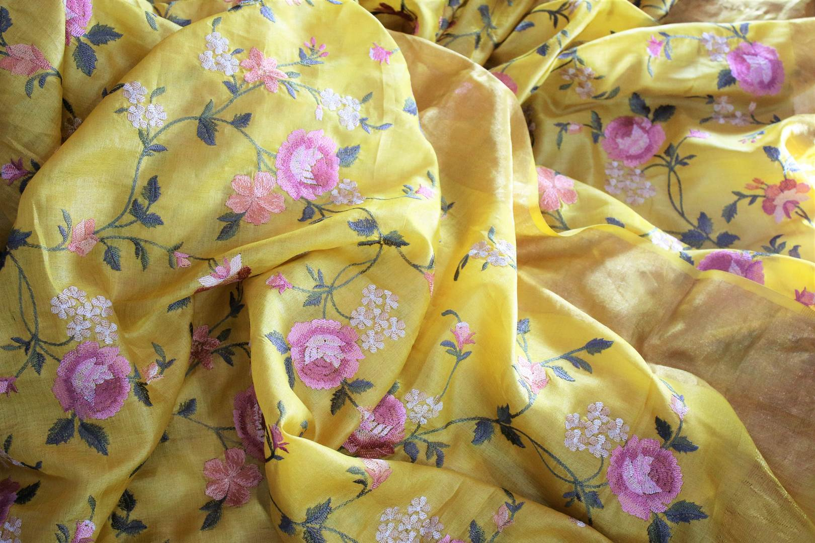 Buy bright yellow silk linen saree online in USA with resham embroidery. Beautifully decorated with floral embroidery and golden border, the saree makes a great choice for daytime festivities or parties. Choose your favorite Indian saree from an exclusive collection available at Pure Elegance clothing store in USA.-details
