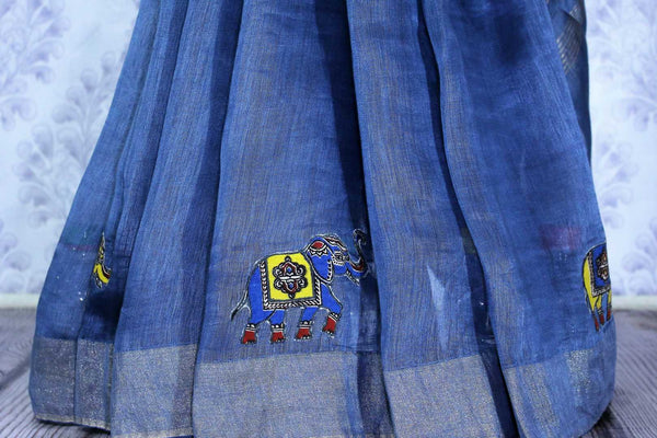 Buy blue printed linen saree online in USA with elephant applique. The elegant saree is a classic drape for an ethnic Indian look at special occasions. Select from an exquisite range of handloom sarees, linen sarees at Pure Elegance Indian Clothing store in USA.-pleats