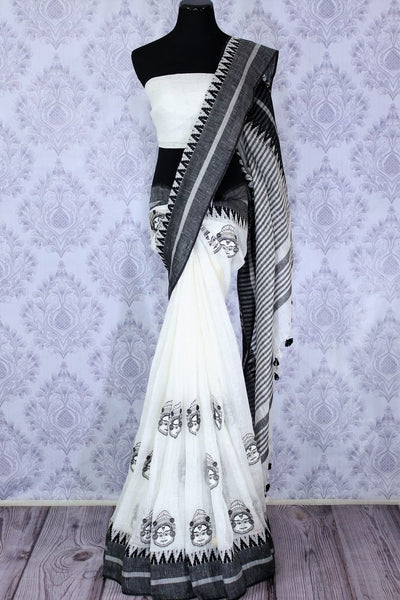 Buy elegant white linen tussar saree with embroidery online in USA. The classic saree is a striking choice for an ethnic Indian look at special occasions. Select from an exquisite range of handwoven saris, designer saris at Pure Elegance Indian Clothing store in USA.-full view