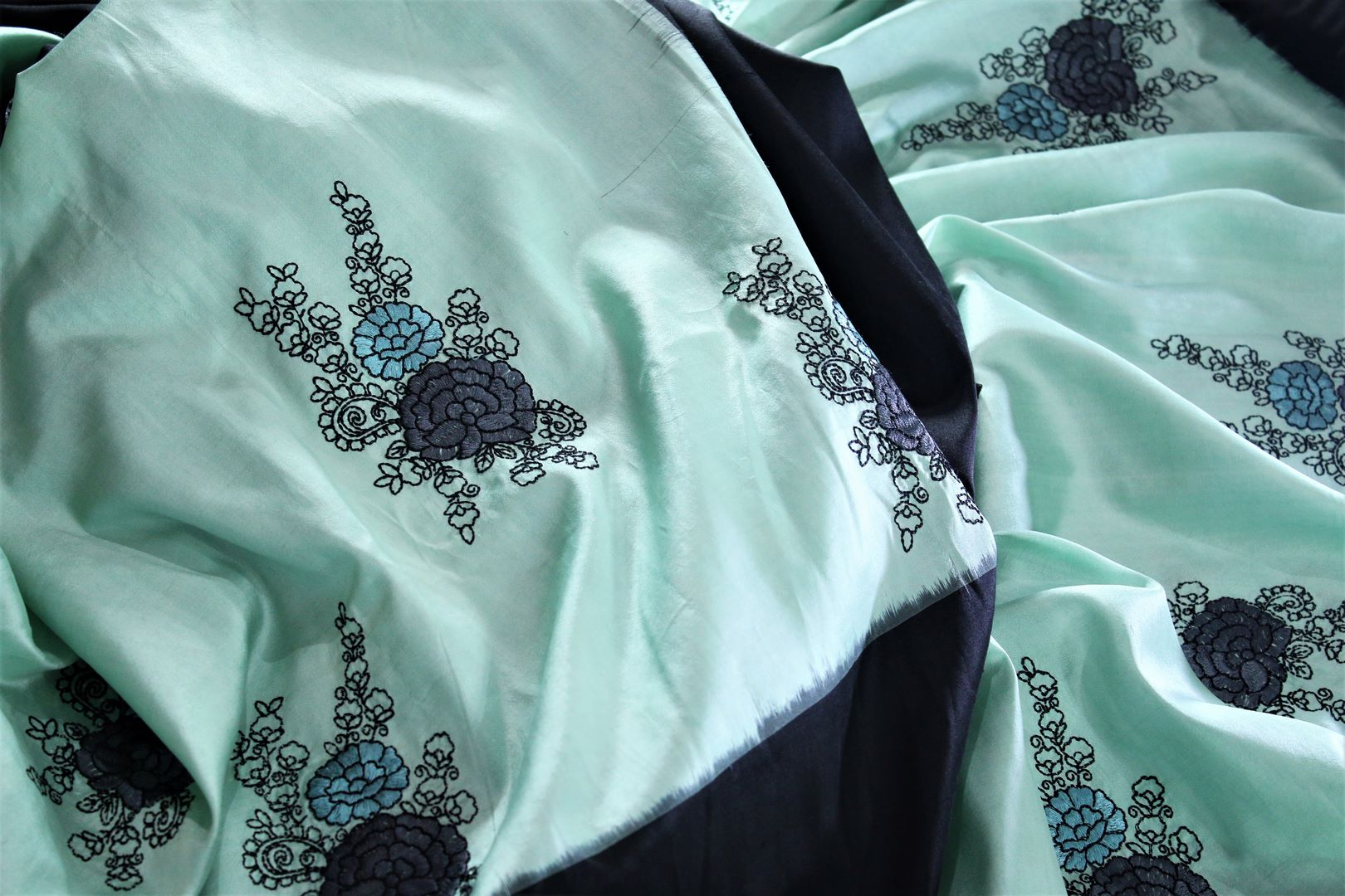 Buy beautiful pastel green ikkat silk saree with resham embroidery online in USA. Make an elegant fashion statement at parties with this alluring drape. Select from an exquisite range of handwoven sarees, designer sarees with blouses at Pure Elegance Indian Clothing store in USA.-details