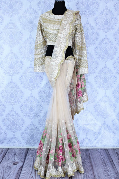 Buy beige color embroidered designer net saree with blouse online in USA. Dazzle at parties with this stylish saree perfect for a glamorous look. Keep your wardrobe updated with a range of latest Indian designer saris in USA available at Pure Elegance Clothing store for women or you can also shop online.-full view