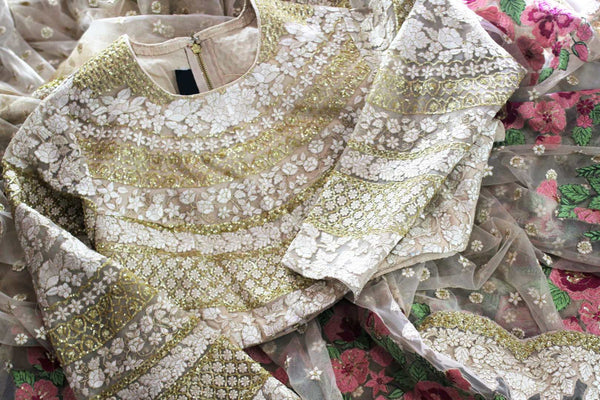 Buy beige color embroidered designer net saree with blouse online in USA. Dazzle at parties with this stylish saree perfect for a glamorous look. Keep your wardrobe updated with a range of latest Indian designer saris in USA available at Pure Elegance Clothing store for women or you can also shop online.-blouse details