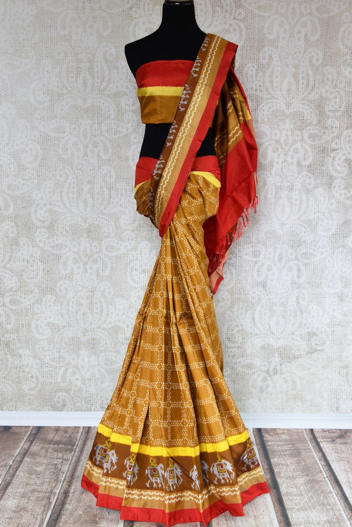 Buy traditional brown ikkat silk saree online in USA. The elegant sari is perfect for a rich Indian ethnic look at festivals and special occasions. Choose your favorite saree from an exclusive collection of Indian designer silk sarees available at Pure Elegance clothing store in USA.-full view