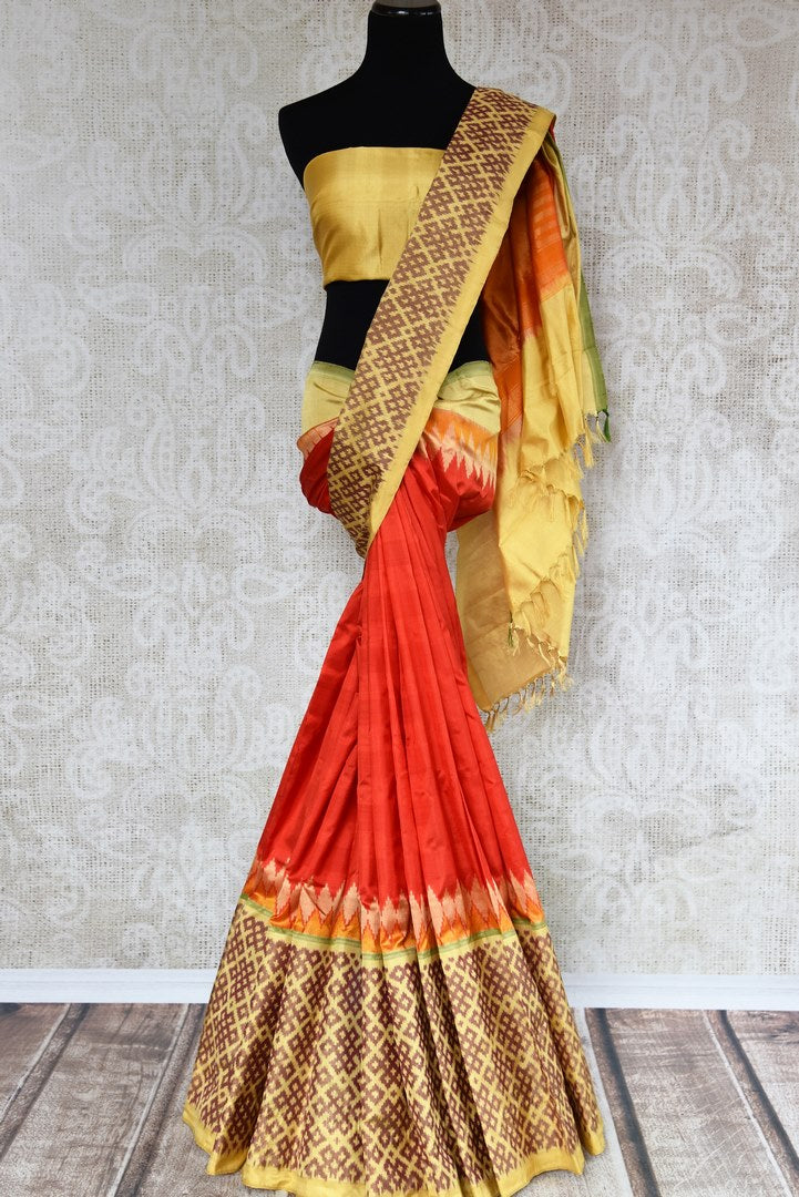 Buy traditional red silk sari online in USA with ikat border. The elegant saree is perfect for a rich Indian ethnic look at festivals and special occasions. Choose your favorite saree from an exclusive collection of Indian silk sarees available at Pure Elegance clothing store in USA.-full view