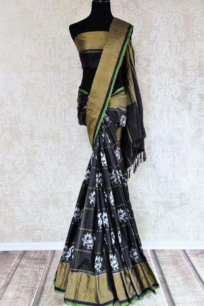 Buy classic black ikat silk saree online in USA. Radiate ethnic elegance at special occasions with this absolutely striking ikat saree with check design. Add more such traditional Indian silk sarees to your wardrobe, available at Pure Elegance clothing store in USA for women or you can also shop online.-full view
