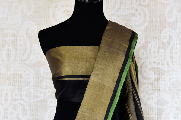 Buy classic black ikat silk saree online in USA. Radiate ethnic elegance at special occasions with this absolutely striking ikat saree with check design. Add more such traditional Indian silk sarees to your wardrobe, available at Pure Elegance clothing store in USA for women or you can also shop online.-blouse pallu