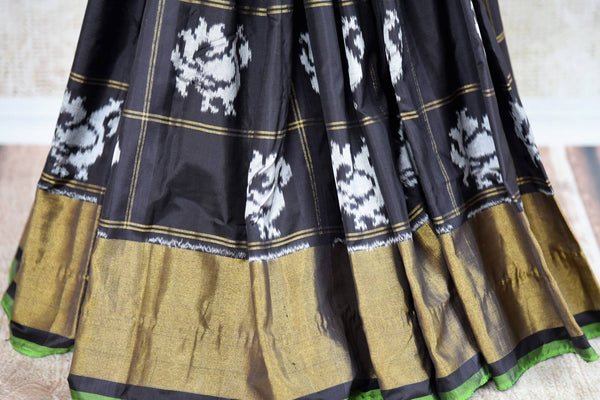 Buy classic black ikat silk saree online in USA. Radiate ethnic elegance at special occasions with this absolutely striking ikat saree with check design. Add more such traditional Indian silk sarees to your wardrobe, available at Pure Elegance clothing store in USA for women or you can also shop online.-pleats