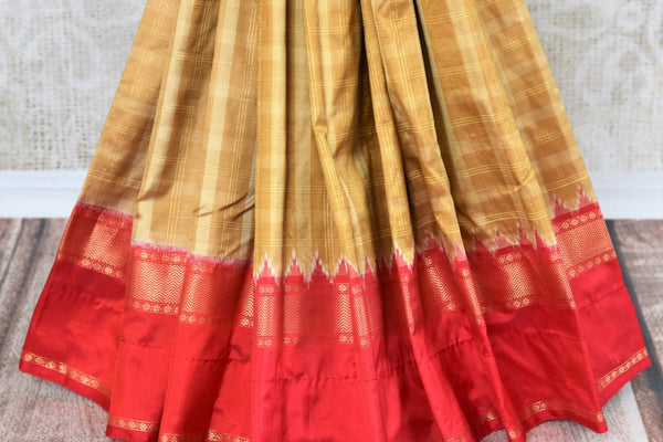 Buy brown ikat Kanjeevaram silk sari online in USA. Shine bright at festivals and special occasions with this absolutely traditional Indian sari. Choose your favorite saree from an exclusive collection of Indian silk sarees available at Pure Elegance clothing store in USA.-pleats