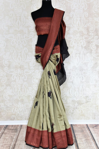 Buy green tussar silk sari online in USA with zari Banarasi border. The alluring drape is a unique choice for festive and special occasions. For more such traditional Indian sarees in USA, shop from the exquisite collection at Pure Elegance Indian clothing store.-full view