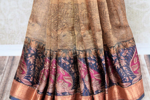 Buy ethnic brown printed kota zari sari online in USA with zari border. The alluring drape is a unique choice for festive and special occasions. For more such traditional Indian sarees in USA, shop from the exquisite collection at Pure Elegance Indian clothing store.-pleats