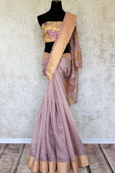 An embellished matka silk wonder, this lavender hued elegant party wear sari is enhanced with the designer embroidered blouse. Shop this gorgeous handwoven Indian designer sarees online or visit Pure Elegance store in USA. - full view