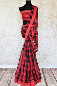 Strike a pose in this picture perfect red and black checkered linen saree with a deep red colored pallu. Style this ensemble with a red blouse. Complete the look with tribal jewelry and a bright smile. Shop handloom sarees, linen saris, silk sarees, Indian dresses online or visit Pure Elegance store, USA. -full view
