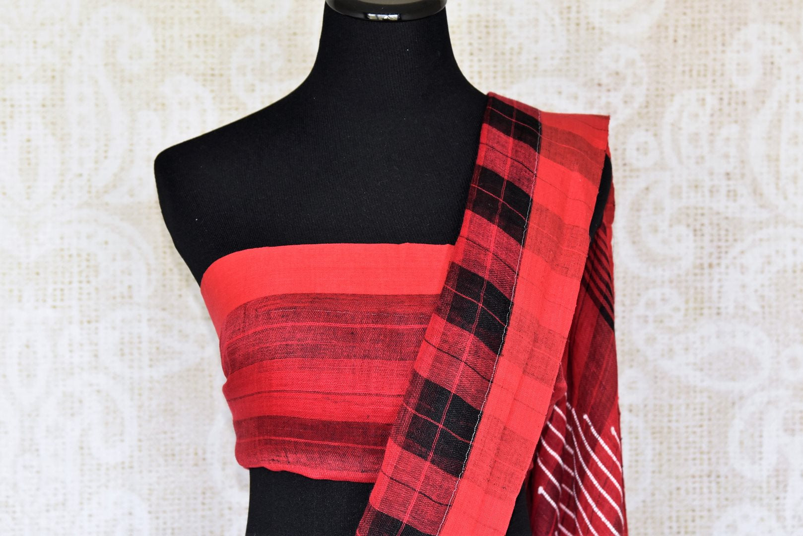 Strike a pose in this picture perfect red and black checkered linen saree with a deep red colored pallu. Style this ensemble with a red blouse. Complete the look with tribal jewelry and a bright smile. Shop handloom sarees, linen saris, silk sarees, Indian dresses online or visit Pure Elegance store, USA. -blouse pallu