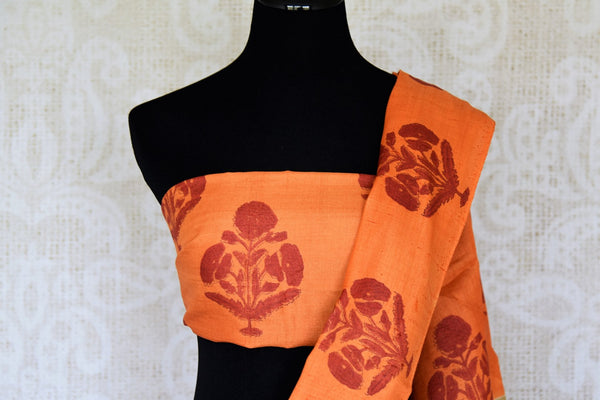 Invest in this simple cream tussar silk printed saree with orange pallu. The checks all over the sari further add to the grace of the nine yards and you can style this beautiful saree with an orange floral printed blouse. Shop handloom sarees, silk saris, printed sari online or visit Pure Elegance store, USA. -blouse pallu