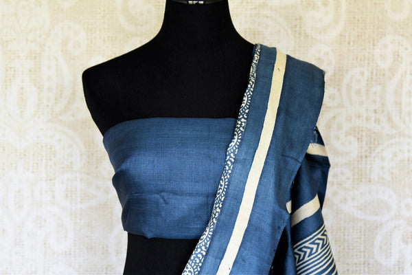 Head to work in style with our exquisitely tailored blue tussar printed saree. It comes with a plain blue blouse. The minimal linear design flowing across the border makes it even prettier. Shop handloom sarees, designer saris, embroidered sarees, ikkat saris, Indian dresses online or visit Pure Elegance store, USA. -blouse pallu