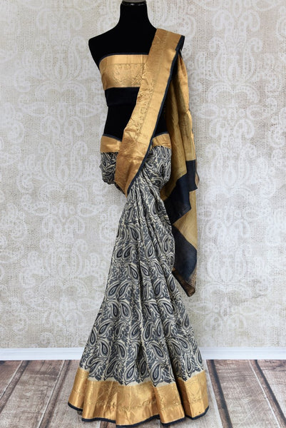 Buy blue printed tussar silk saree online in USA with golden border. The alluring drape is an elegant choice for festive and special occasions. For more such traditional Indian saris in USA, shop from the exquisite collection at Pure Elegance Indian clothing store.-full view