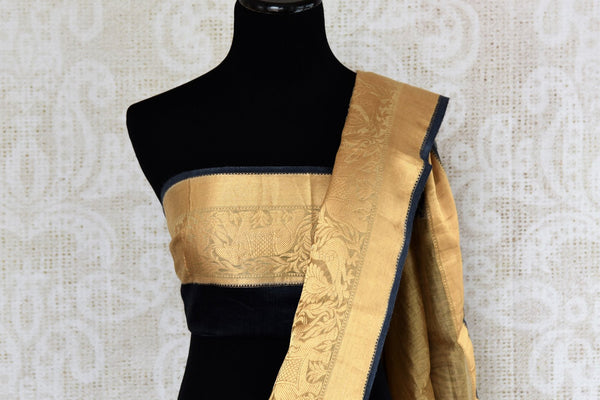 Buy blue printed tussar silk saree online in USA with golden border. The alluring drape is an elegant choice for festive and special occasions. For more such traditional Indian saris in USA, shop from the exquisite collection at Pure Elegance Indian clothing store.-blouse pallu
