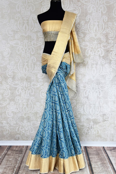 Buy blue printed linen tussar silk saree online in USA with Banarasi border. The alluring drape is a unique choice for festive and special occasions. For more such traditional Indian handloom saris in USA, shop from the exquisite collection at Pure Elegance Indian clothing store.-full view