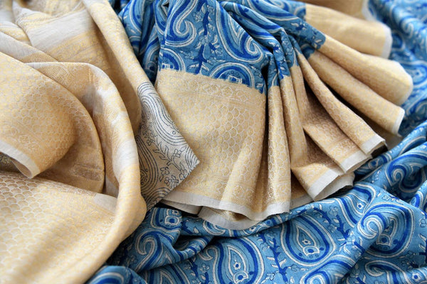 Buy blue printed linen tussar silk saree online in USA with Banarasi border. The alluring drape is a unique choice for festive and special occasions. For more such traditional Indian handloom saris in USA, shop from the exquisite collection at Pure Elegance Indian clothing store.-details